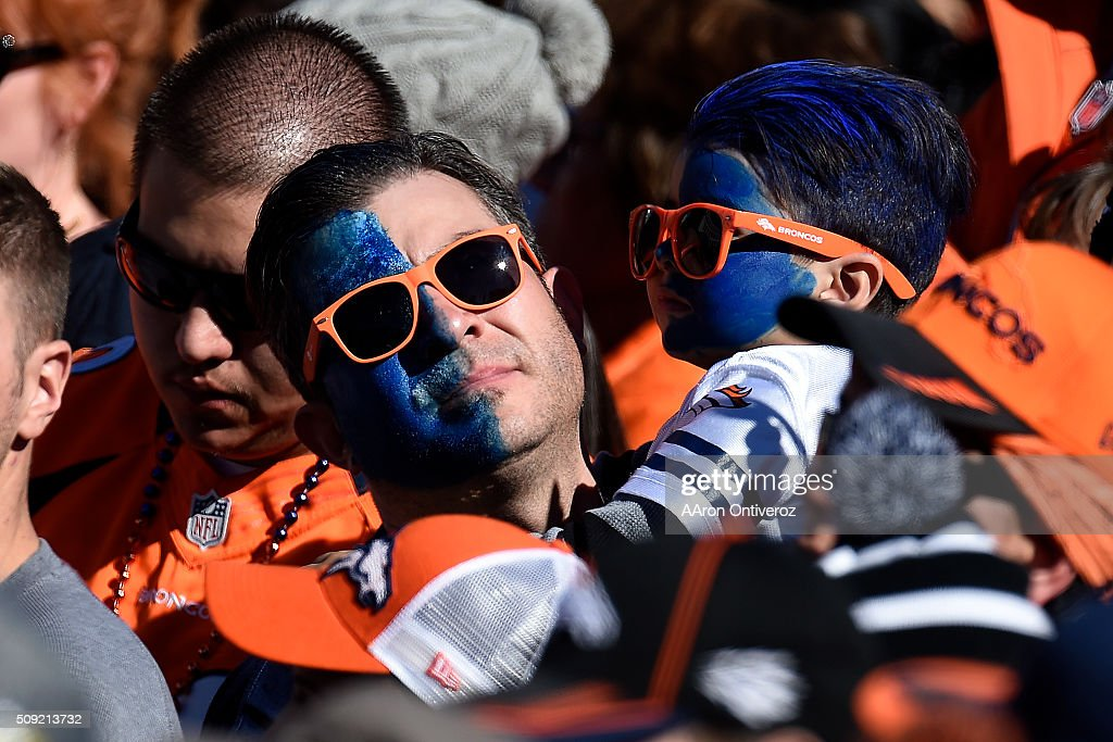 A man and boy wear face point to support their team in Civic Center Park during the Denver Broncos Super Bowl championship celebration and parade on Tuesday February 9, 2016.