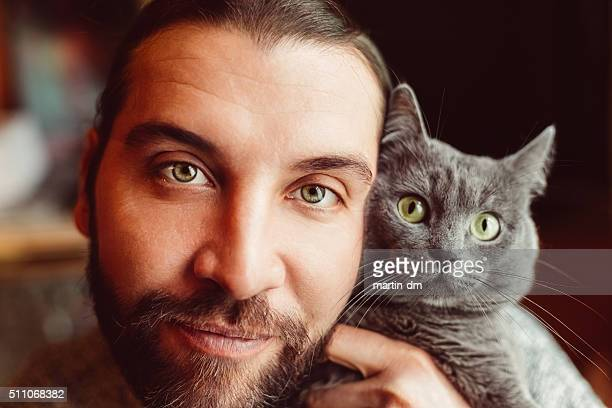 Man and cat taking selfie