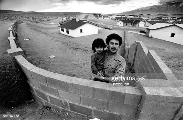 Man and Daughter above homes Rio Rancho To the right of Gilbert Romero's brand new home is the city of Rio Rancho « New Mexico The the left is the...