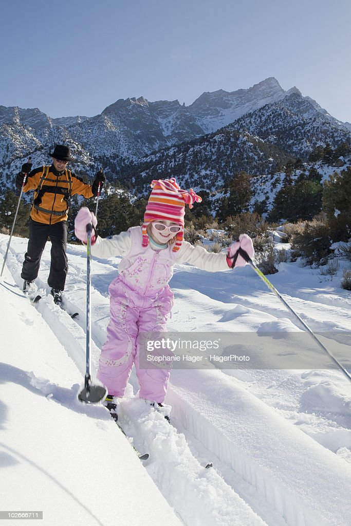 Man and daughter cross country skiing : Stock Photo