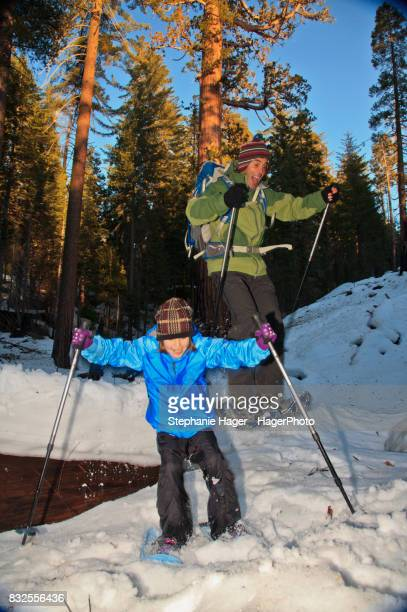 Man and daughter snowshoeing