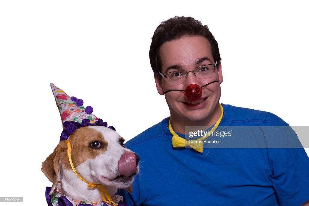 Man and dog as clowns : Stock Photo