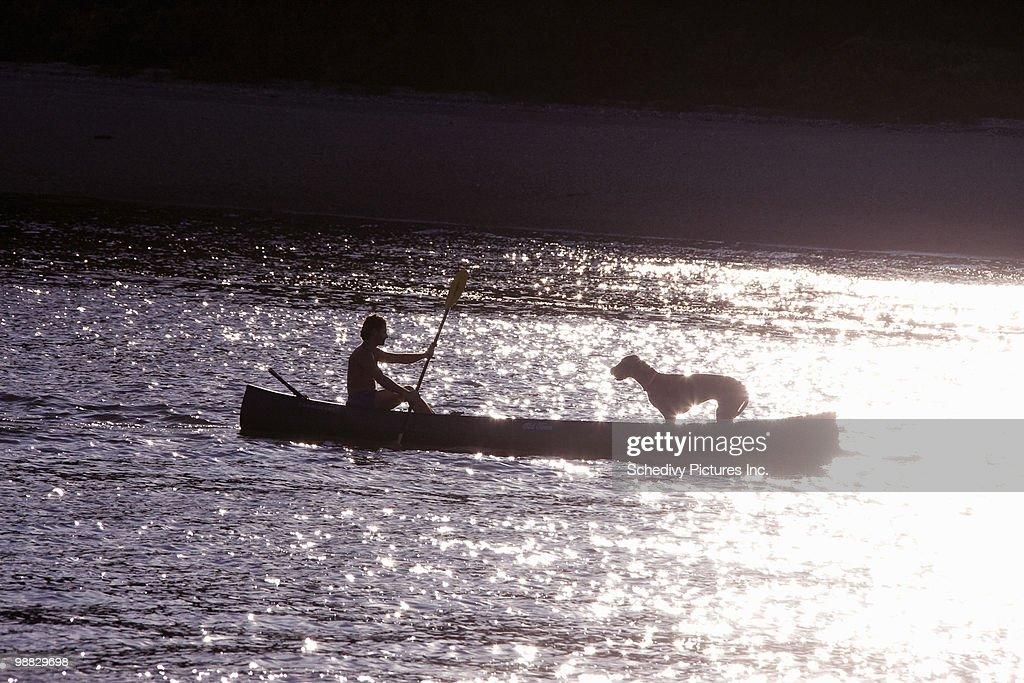Man and dog in canoe Huntington Bay NY