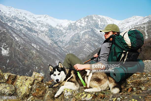 Man and dog in mountain hike