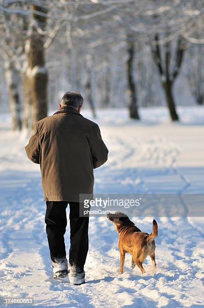 Man and dog in winter park