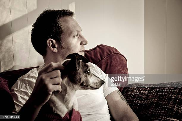 Man and Dog looking out window