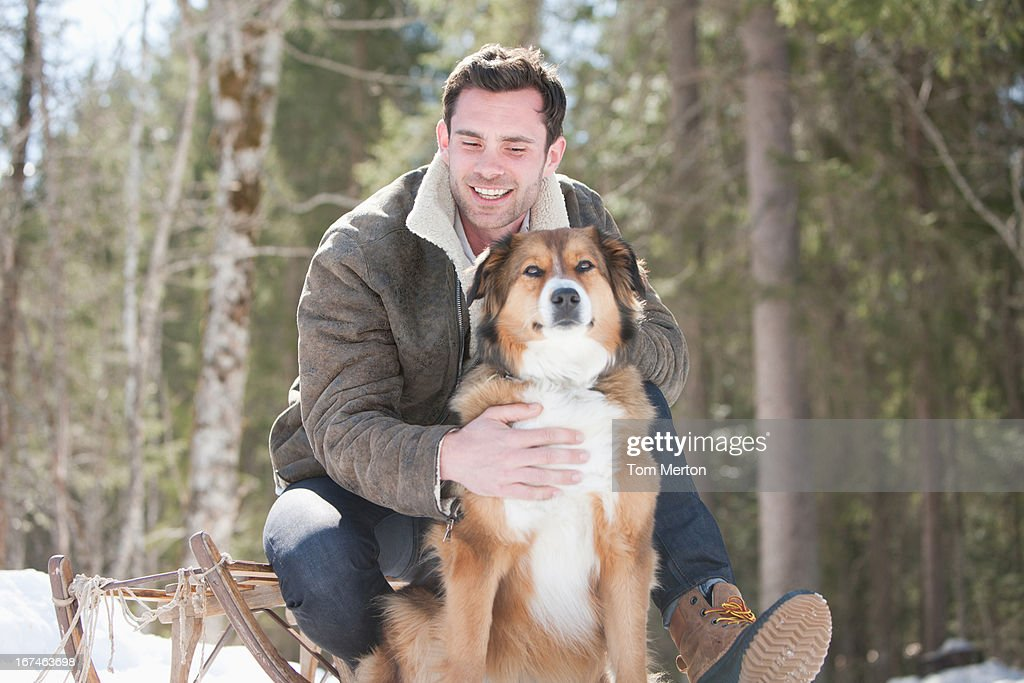 Man and dog outdoors, winter : Stock Photo