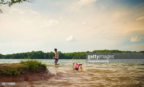 Man and dog walking in a lake, Loudon, Tennessee, USA