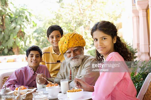 Man and grandchildren at breakfast table