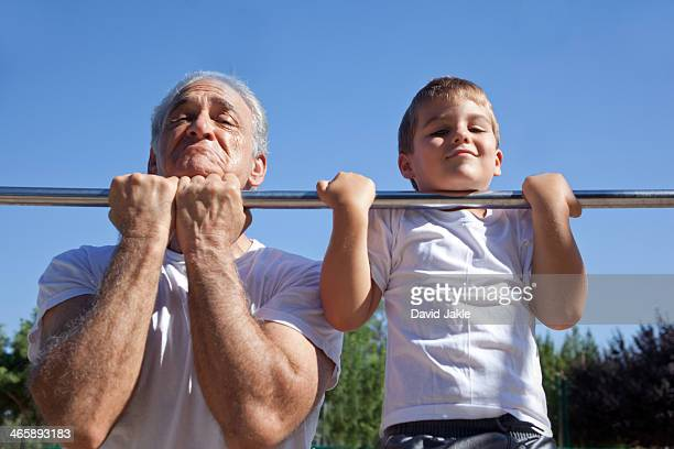 Man and grandson doing chin-ups