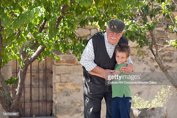 Man and grandson hugging outdoors