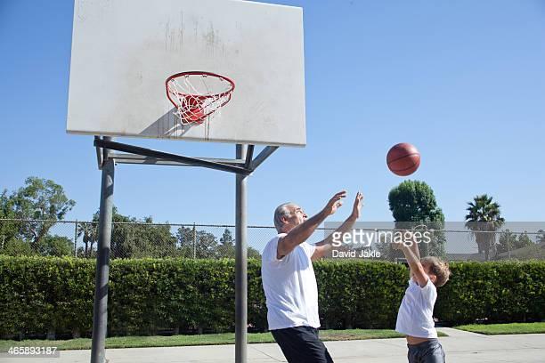 Man and grandson playing basketball