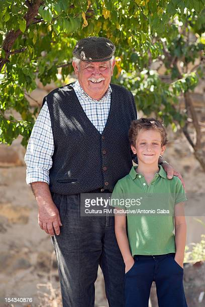 Man and grandson standing outdoors