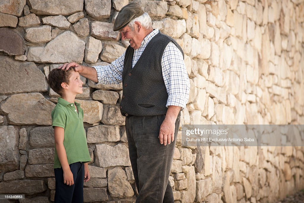Man and grandson talking outdoors