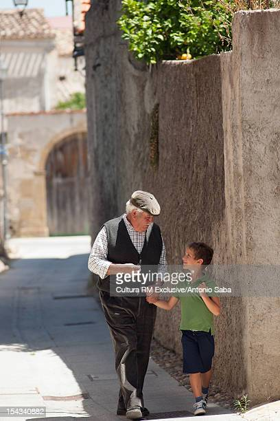 Man and grandson walking outdoors