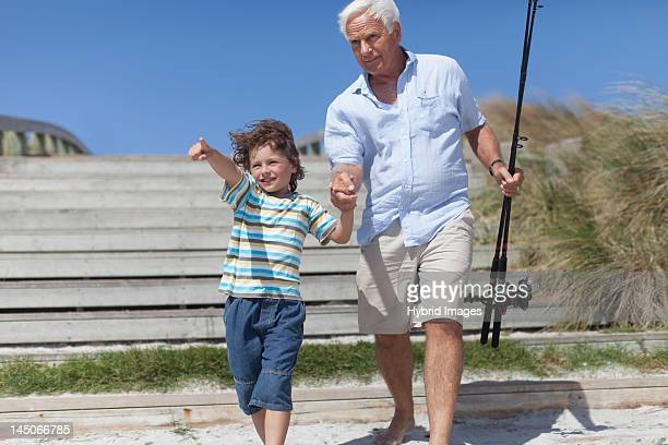 Man and grandson with fishing poles