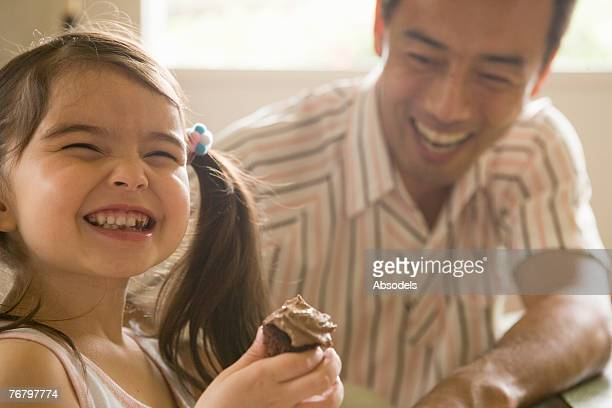 A man and his daughter laughing