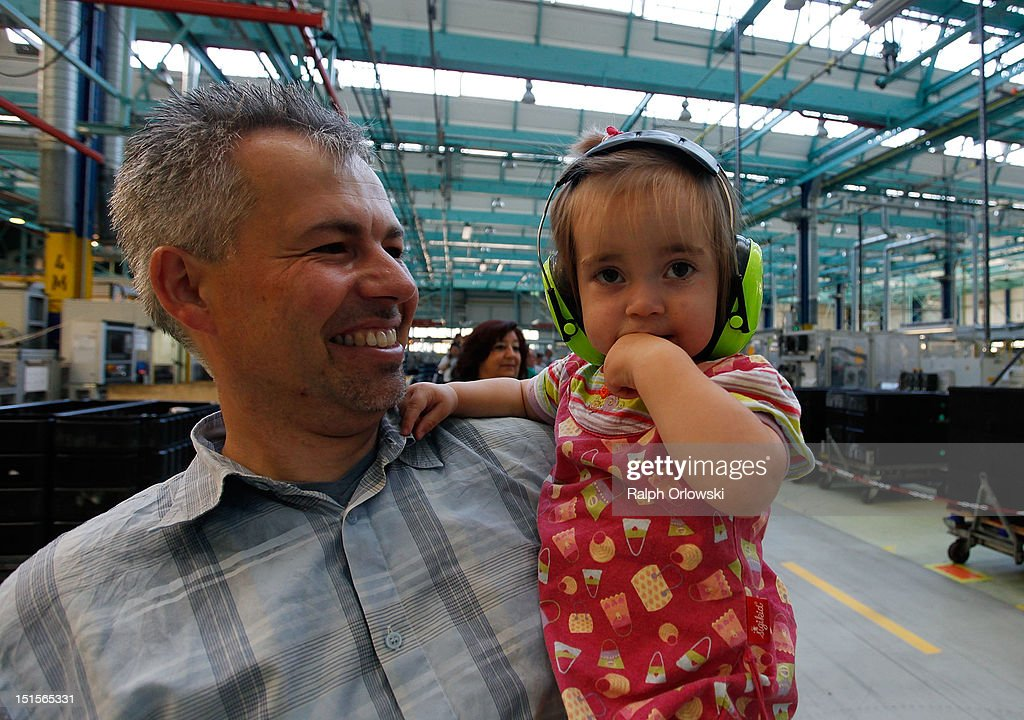 A man and his daughter visit the manufacturing plant of German car maker Adam Opel GmbH on September 8, 2012 in Kaiserslautern, Germany. Automaker Opel, founded in 1862, celebrates their 150th anniversary.