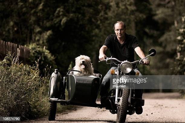 Man and his dog on motorcycle with side car