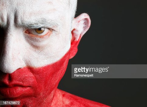 Man and his face painted with the flag of Poland : Stock Photo
