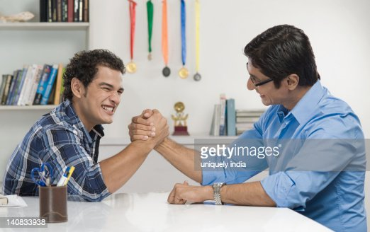 Man and his father arm wrestling