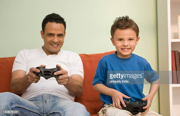 Man and his son playing a video game
