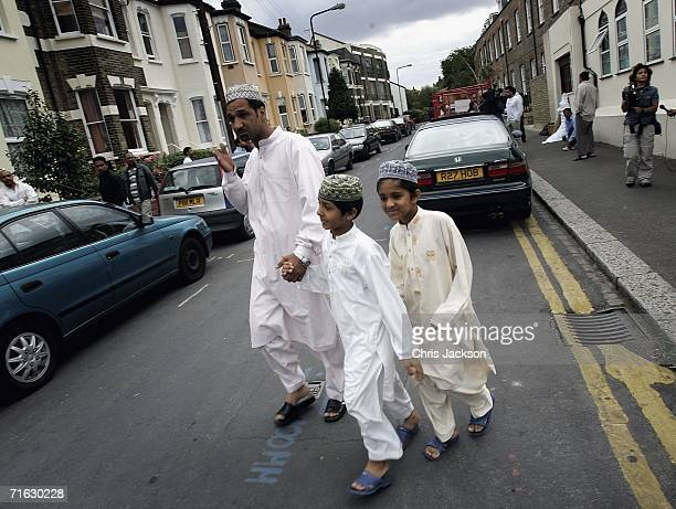 A man and his two children head home after prayers at the Dar Al Uloom Qadria Jilania Mosque and Religious School in Walthamstow on August 11 2006 in...