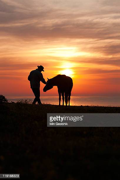 Man and horse with sunrising