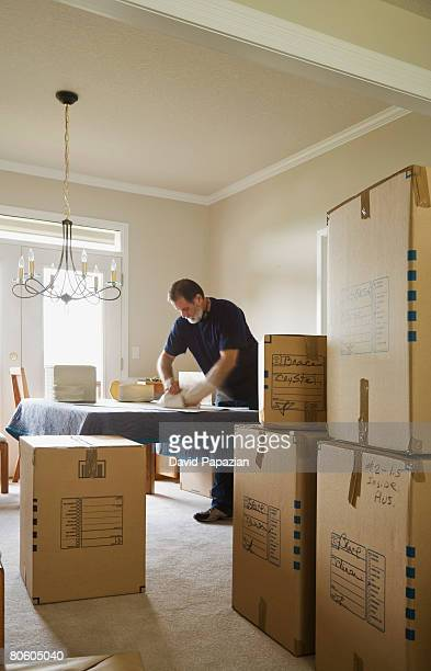 Man and packing boxes