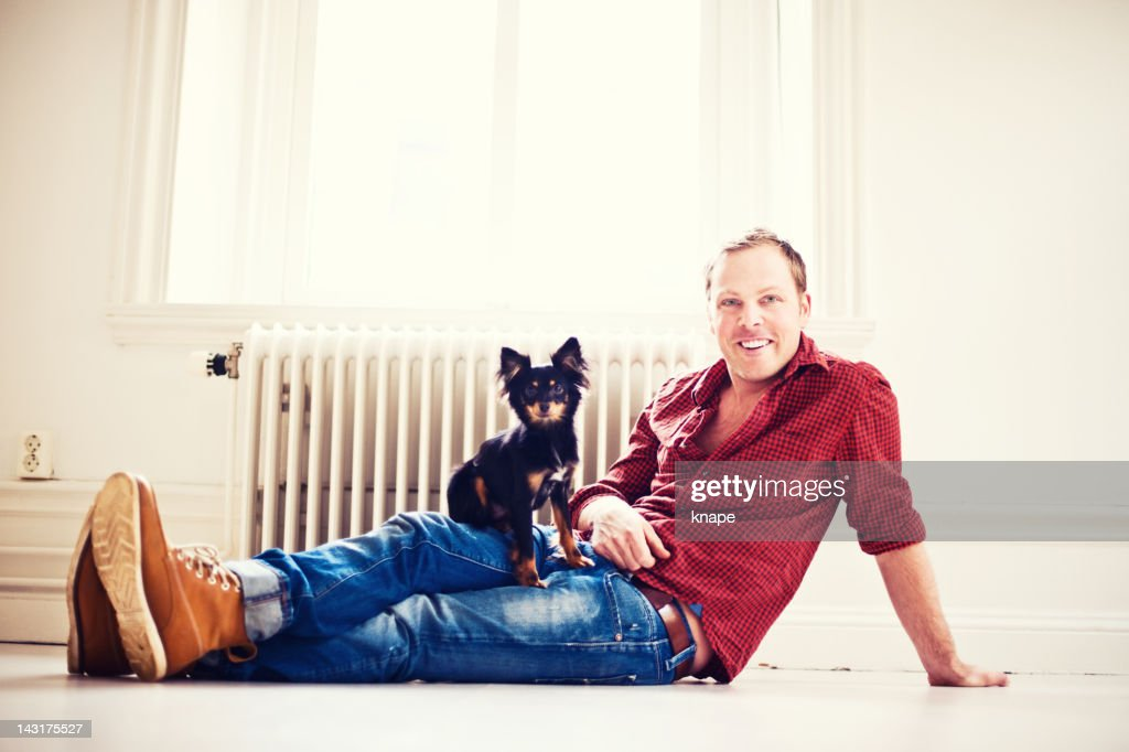 Man and russkiy toy : Stock Photo