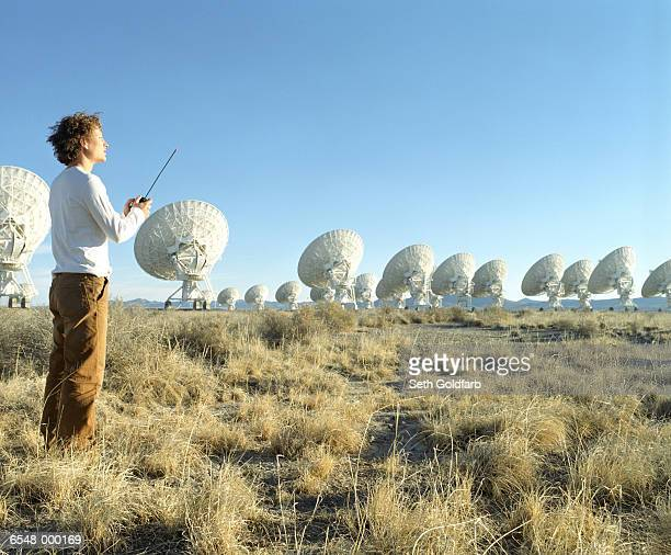 Man and Satellite Dishes