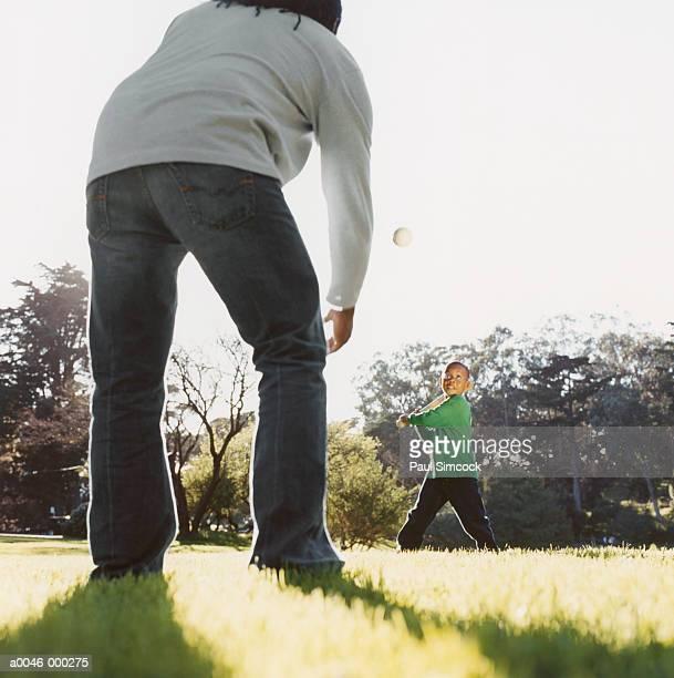 Man and Son Playing Softball