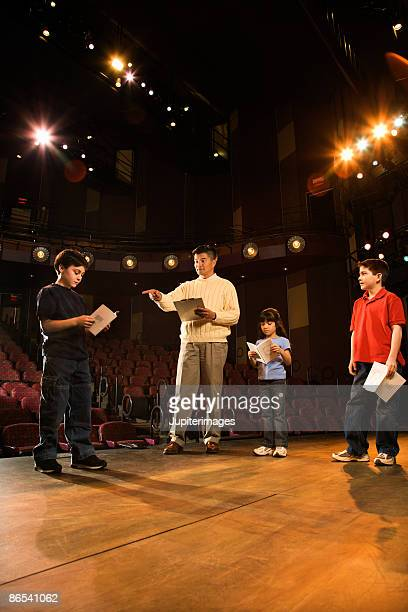 Man and students practicing a play