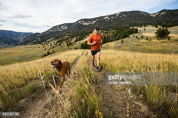 A man and  trail running