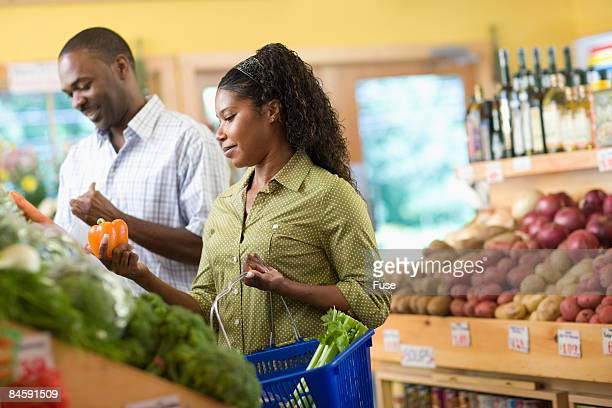 Man and Wife Shopping for Groceries