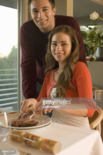 Man and woman at dining table