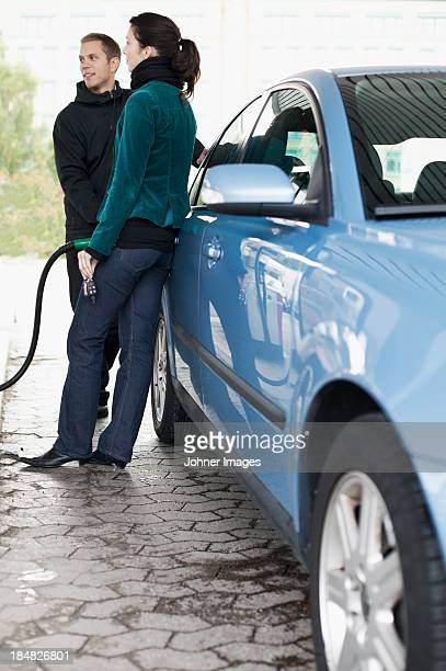 Man and woman at gas station
