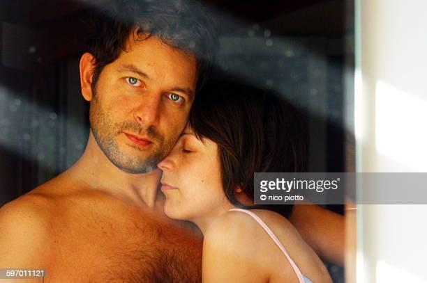 Man and woman at mirror