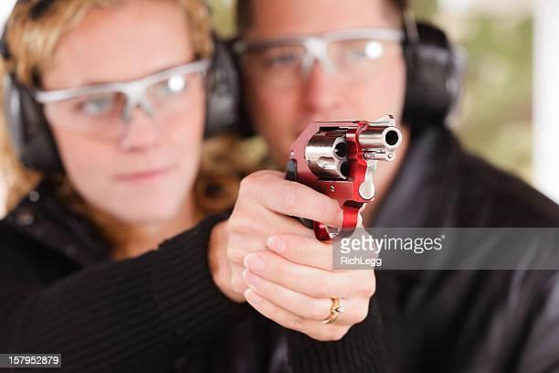 Man and Woman at the Shooting Range