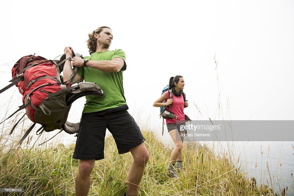 A man and woman backpacking. : Stock Photo