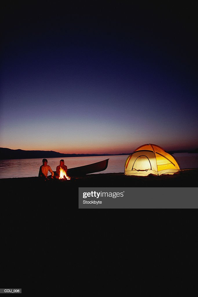 Man and woman camping : Stock Photo