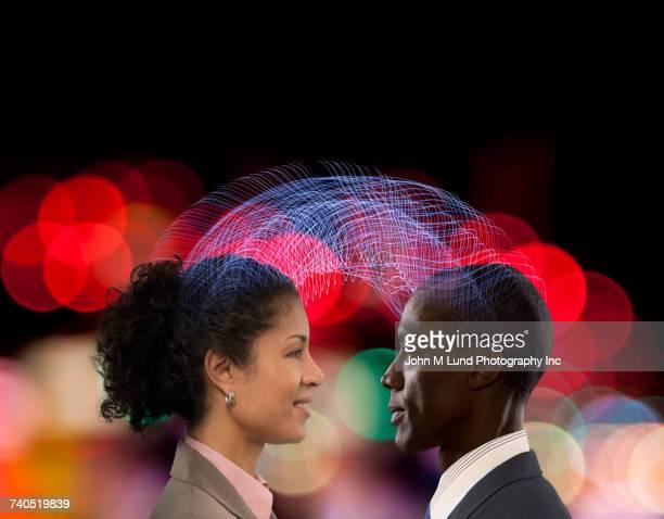 Man and woman communicating using telepathy