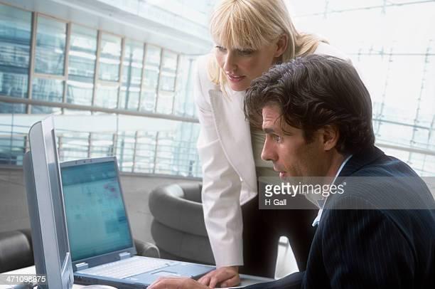 man and woman computer