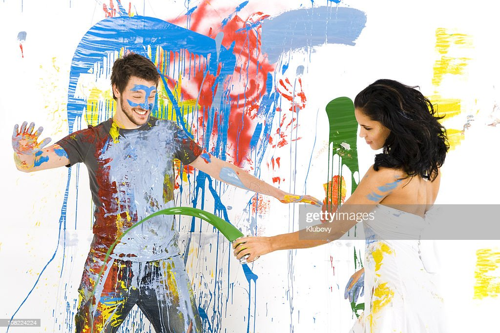 Man and Woman Covered in Paint