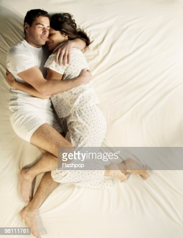 A Man And A Woman In Bed