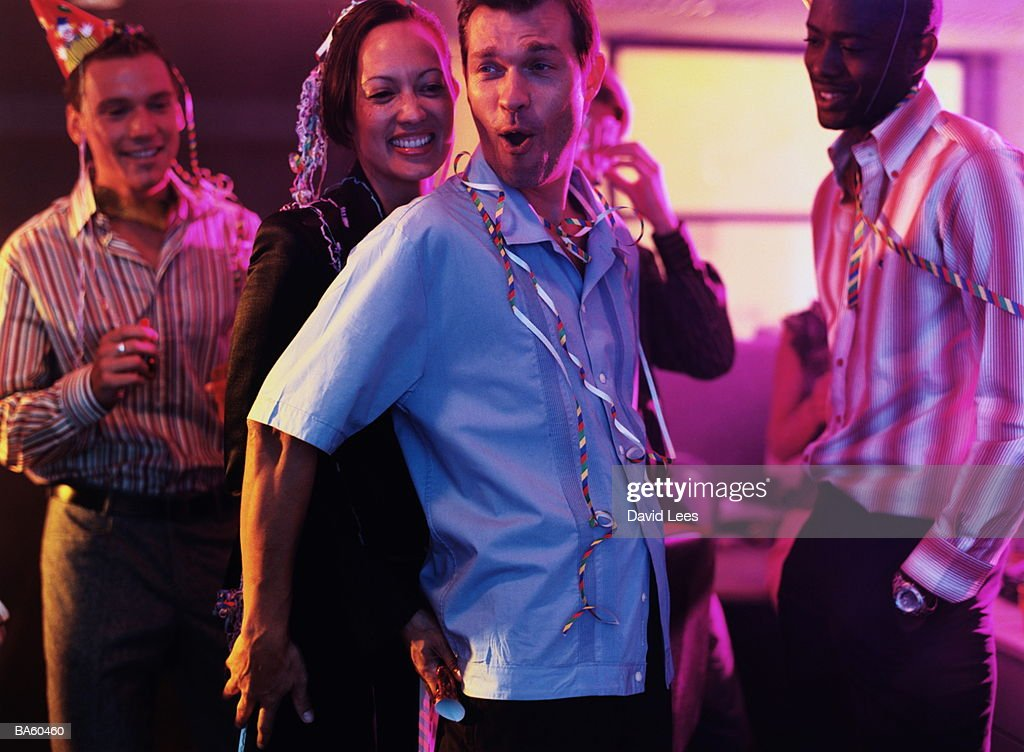 Man and woman dancing at office party : Stock Photo