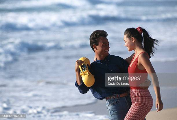 Man and woman dancing on beach