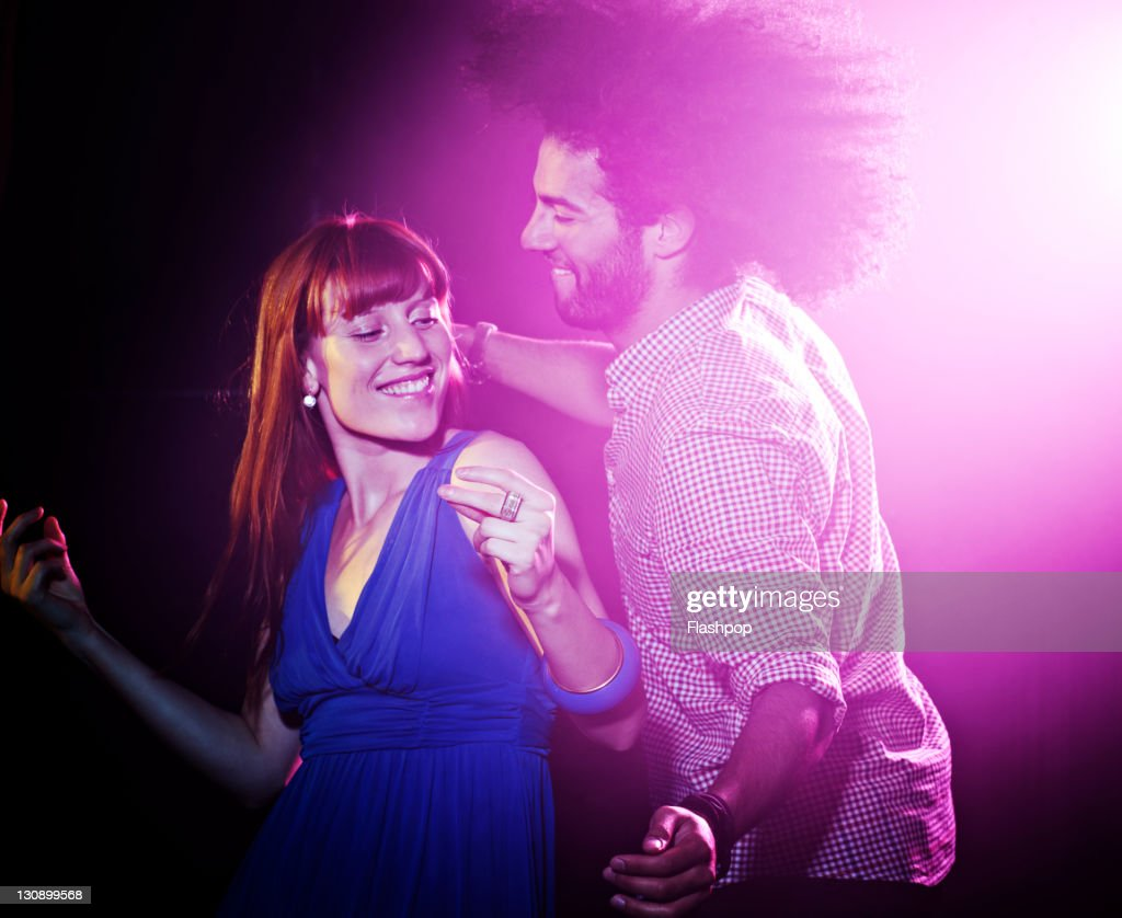 Man and woman dancing together : Stock Photo