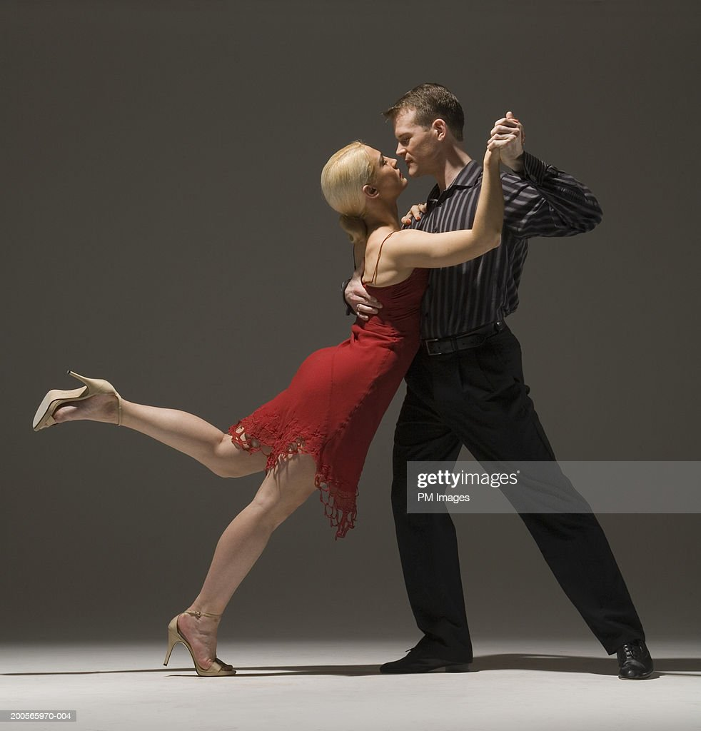 Man and woman dancing, touching noses, side view : Stock Photo
