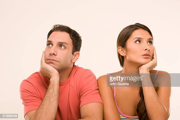 Man and woman disinterested in each other.